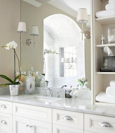 sconces mounted on mirror // shelves // details on counter / bath