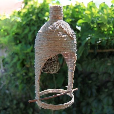 Bird feeder made from a plastic bottle birds juxtapost for How to make a bird feeder using a plastic bottle