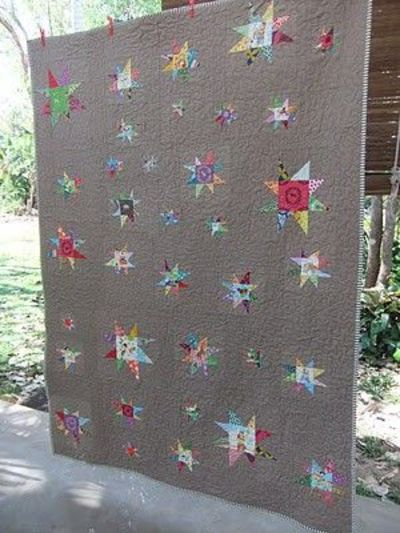 Gorgeous floating wonky stars of all sizes by Melissa
