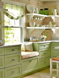 Built -in Window seat with drawers and shelving . . . nice green accent.