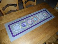 circle table topper - it would look cool in Christmas fabrics