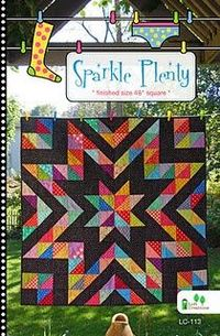 Sparkle Plenty quilt - love the radiating star pattern.