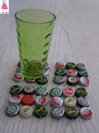 simple way to make bottlecap coasters. the blog is in Greek but the jist of it is to make pinholes in the sides of the caps, pass wire through the holes and bend using needlenose pliers.