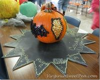 decorate a pumpkin with thumbtacks