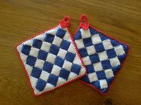KarinV's Delftware potholders - a *great* project to practice or become familiar with the entrelac technique. I really like this pattern because the crocheter gives directions for adding the little triangles to make the edges straight. Red trim with t...