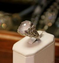 Judith Ripka Sterling Silver Ring, with faceted rose quartz and amethyst. $325 size 7