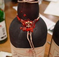Wrap a ribbon around a bottle and add a wax seal.