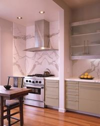 I love marble slabs used on the backsplash! Marble, granite, it's earth's art and you can really really appreciate it when it's on the wall!