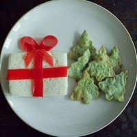 Fun kids lunch - present sandwich tied with fruit roll up & spinach tortilla tree chips w/ hummus dip