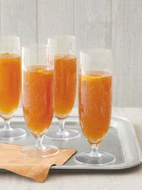 Country Living's Orange-Cherry Champagne Cocktail. This would be fabulous on New Years Eve!