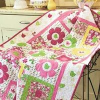 All A-Twitter wall quilt pattern featuring cute birds and cheery appliquéd flowers is fast and fun to make. Our FREE online video shows you how to secure the appliqués with machine quilting. Featured in McCall's Quick Quilts June/July 2012. McCallsq...