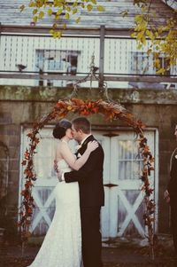 Wedding arch covered in fall leaves. Not sure how to incorporate an arch like this, but it seems like the ceremony site needs something photo by Amy Carroll