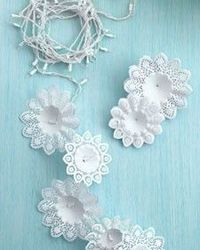 use bouquet holders as snowflakes around lights