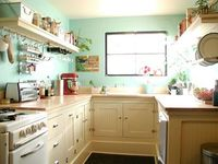 tiny cottage kitchen - like the bead board cabinets, open shelves, and wall color