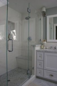 the main bath floor is Carrara marble tiles cut 6x12 and in the shower it's a Carrara marble hexagon mosaic