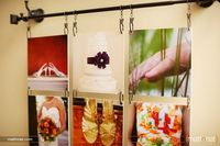 hanging photo collage ~ photos linked together with links then hung from a curtain rod resting on 2 coat hooks... check out the other photos of this great idea!