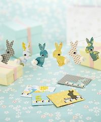 Make Kirsty Neale's quirky rabbits, complete with fabric bows, stacked buttons & pom-poms!