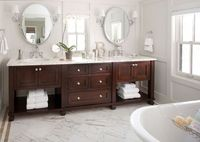 Chalet Development Stunning master bathroom with gray walls paint color, walnut stained double bathroom vanity with calcutta gold marble countertops, Restoration Hardware Oval Pivot Mirrors, Restoration Hardware Wilshire Single Sconces, orchid and calcutt...