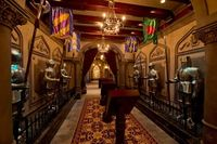 Suits of armor in the hall leading to the quickservice dining experience at Be Our Guest restaurant in Walt Disney World.