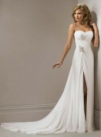 Strapless, slim line gown with sweetheart neckline and corset closure. This Gossamer Chiffon design features delicate detail ruching throughout the bodice met with a burst of jeweling that reveals a sexy side slit down the side skirt. This fabulous jeweli...