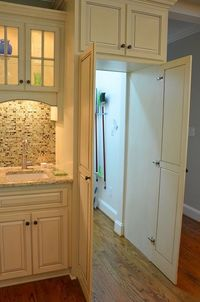 Cool concept. Walk in pantry door concealed within the kitchen cabinets. Amazing!