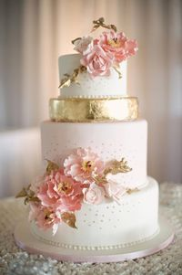 gold white flowers pink pale wedding cake