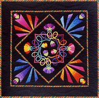 "A Celtic Rainbow of Flowers 38"" (97cm) wallhanging pattern is available as a printed pattern or an e-pattern."