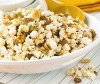 This fun snack mix is perfect for a party. It's filled with candy corn, popcorn, pretzels, corn nuts, cereal squares, and toasted #pumpkin seeds.