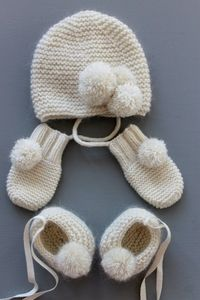 baby set, baby booties, baby hat and baby mittens.