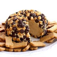 """Peanut Butter """"Cheese Ball"""". 1 package (8 ounces) cream cheese, at room temperature 1 cup powdered sugar 3/4 cup creamy peanut butter (not all-natural) 3 tablespoons packed brown sugar 3/4 cup milk chocolate chips 3/4 cup peanut bu..."""