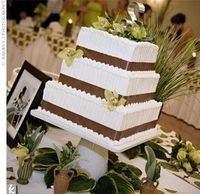 three-tiered wedding cake was frosted with buttercream and decorated with green cymbidium orchids. theknot.com