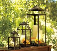 fill lanterns with candles and flowers