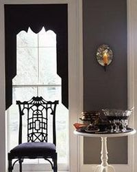 This Halloween, decorate by replacing fabric curtains with elegant, gothic-inspired ones made of paper.