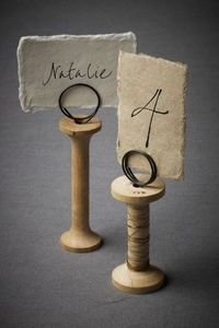 Spools. A cute way to display table numbers.