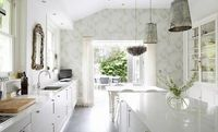 every time I think I have seen the sweetest kitchen, along comes an even sweeter one... would you look at that gray print wallpaper, the sweet gold mirror, the antiqued/mercury glass pendant lights w/the gray capiz-shell light fixture, the white/glass cab...