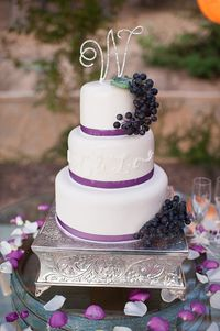 Simple white wedding cake with grape accents - wedding