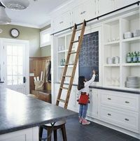 With extra storage behind the chalkboard