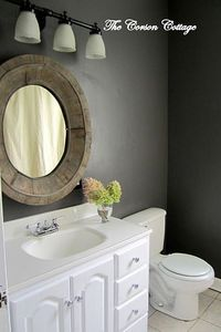 Gray bath with wood mirror