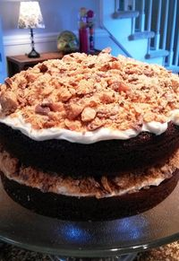 Chocolate Butterfinger Cake... SUPER easy but impressive (cake mix, can of frosting, sundae syrup and butterfingers - that's it!)