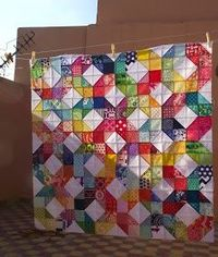 Lovely, bright Patchwork Wheel quilt top from Anabella of Life's Rich Pattern.